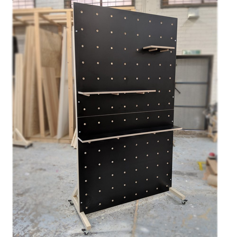 black freestanding pegboard on wheels